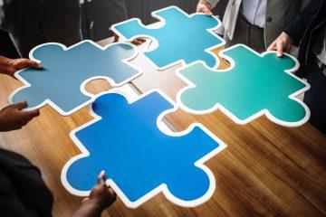 Business planning jigsaw rawpixel-659503-unsplash